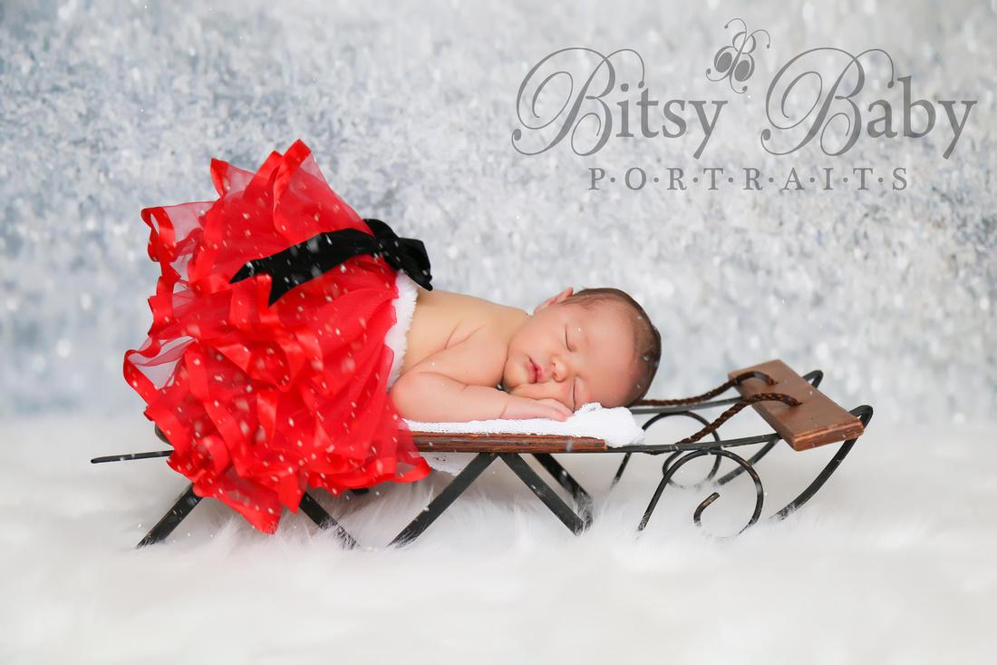 Christmas baby on sleigh with snow
