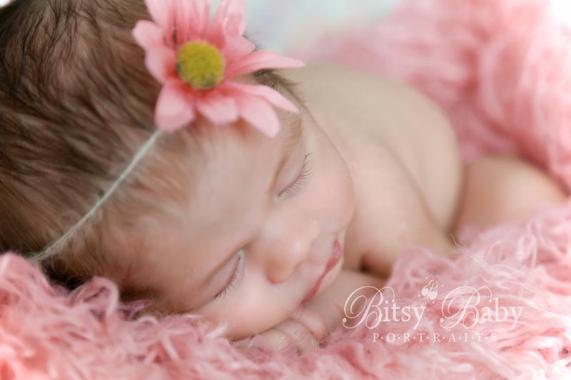 newborn photography, baby, eyelashes, pink Flokati rug