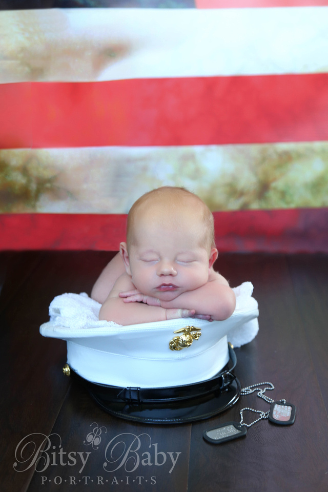 Baby on a marine's hat