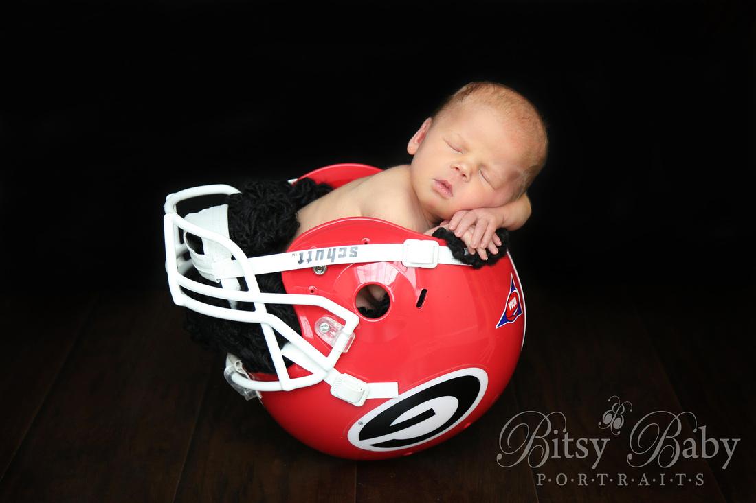 """Baby in a football helmet"""