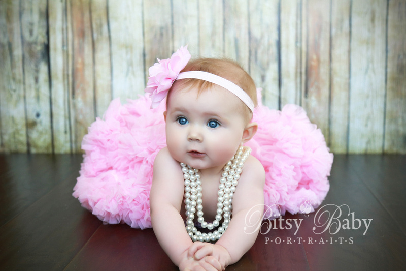 Baby in a pink tutu with pearls, 6-month old