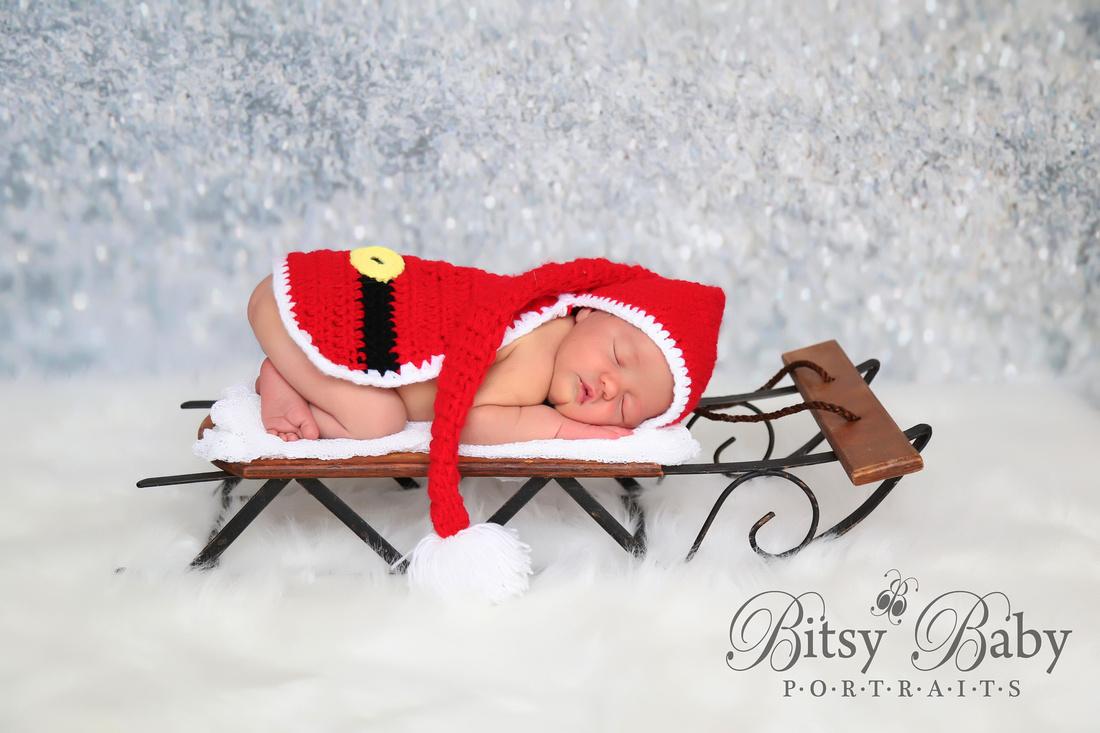 Santa baby on a sleigh