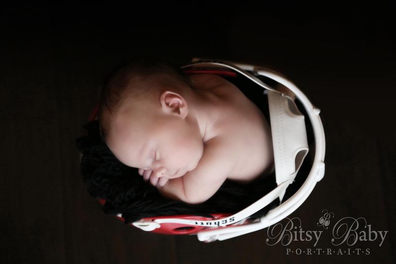 Baby in a UGA helmet