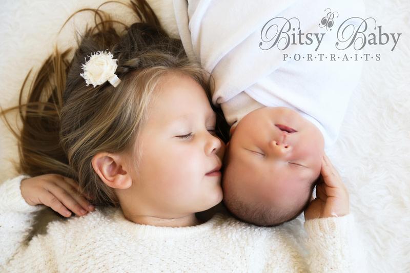 """baby with big sister"" on rug"