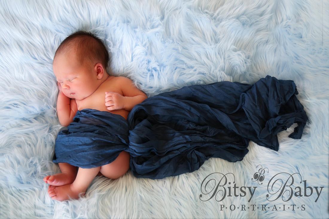baby on blue Flokati rug, newborn