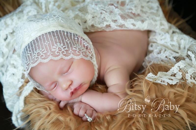 Newborn photography, vintage stroller, lace, Flokati rug, baby