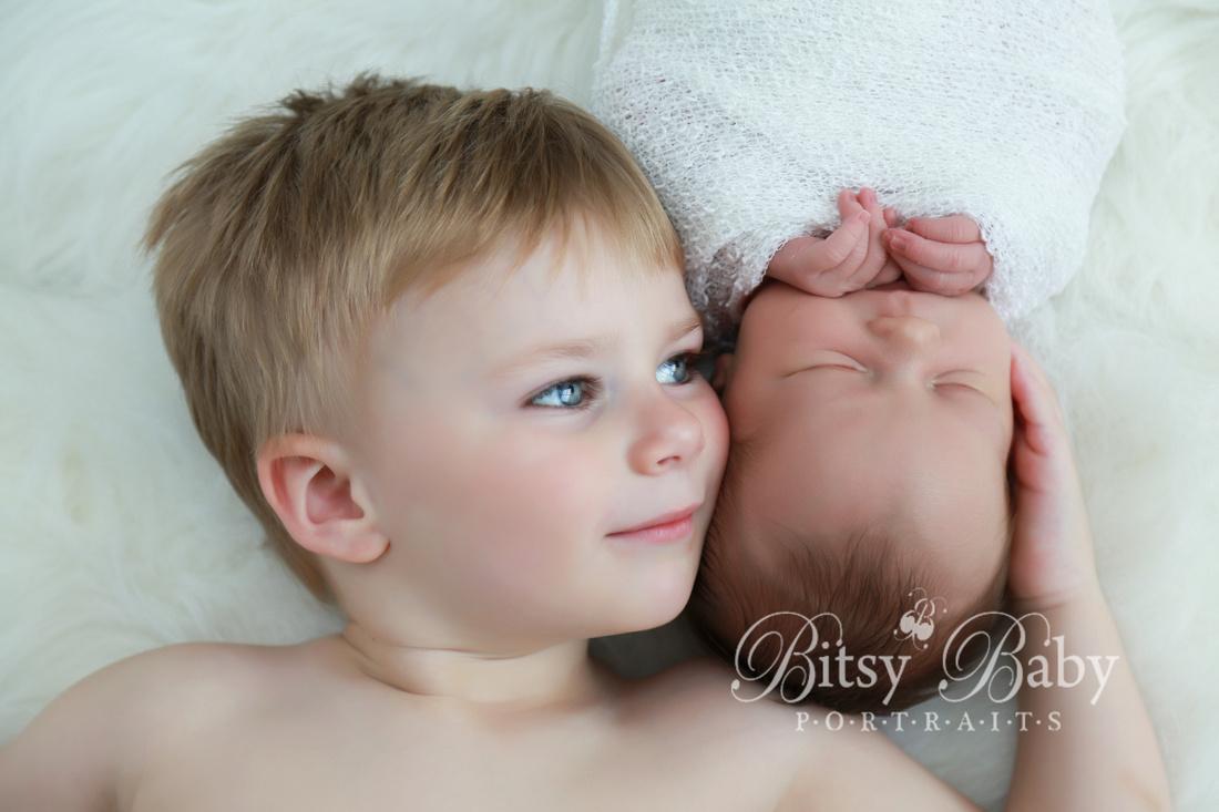 Newborn photography, big brother and baby sister, white Flokati