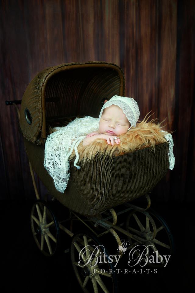Newborn photography, vintage stroller, lace