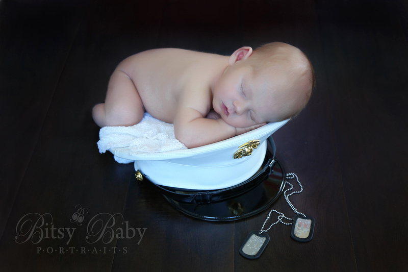 Baby on a Marine's hat with dogtags