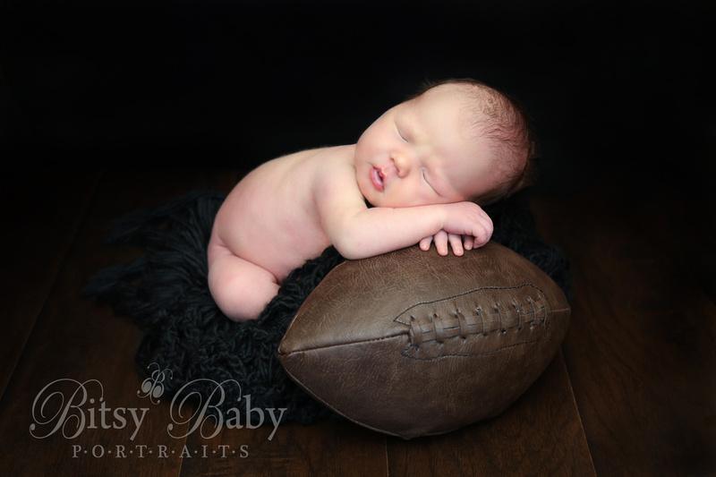 """baby on football"""