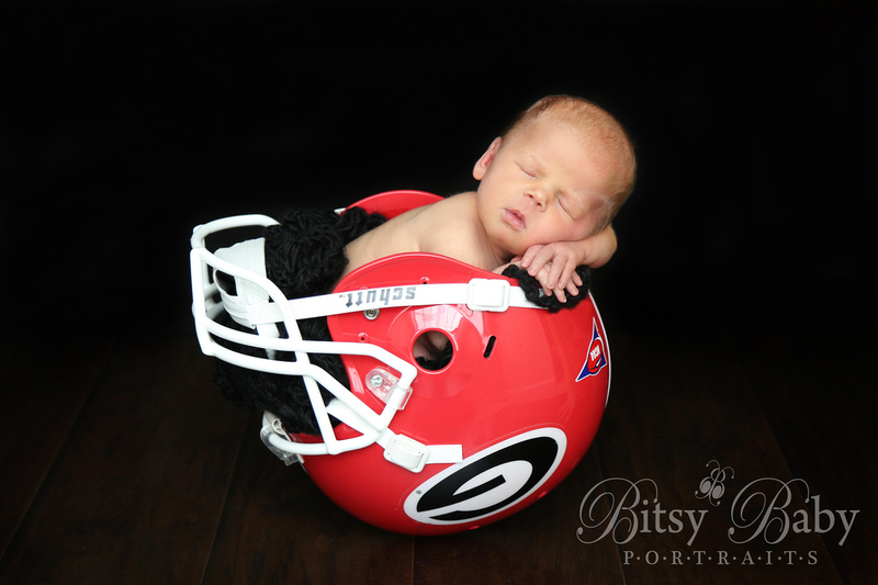 """Baby in a football helmet"""
