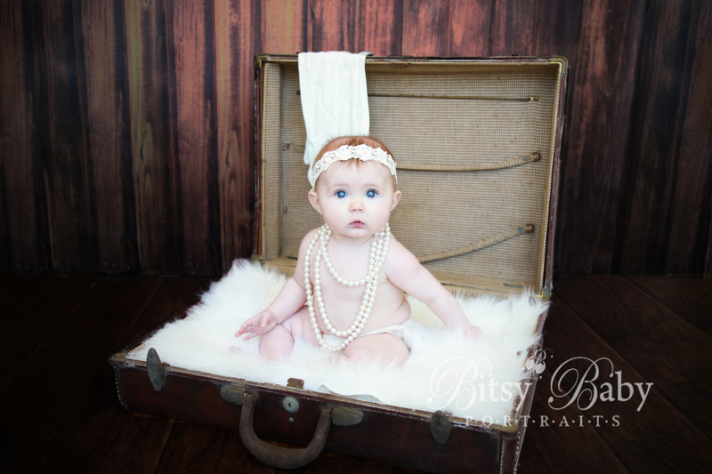 Baby in antique suitcase, luggage