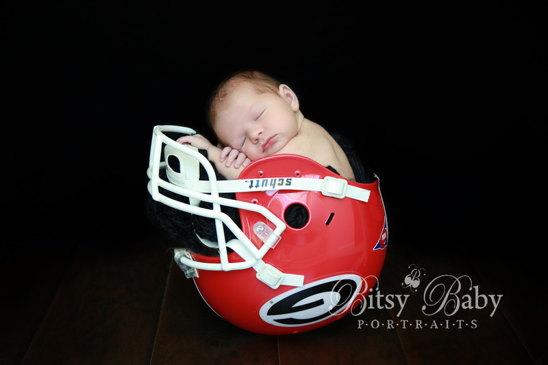 newborn photography, baby in a Georgia Bulldog helmet