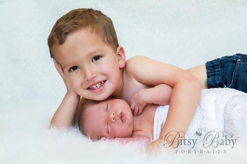 newborn photographer, baby photographer, Athens GA, white rug, big brother