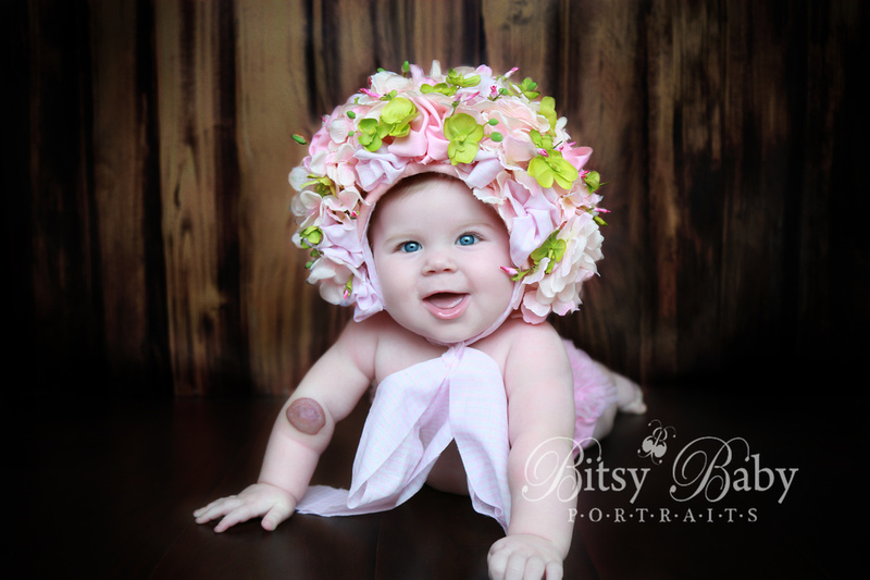 6-month baby photo session, flower hat, lime green rug