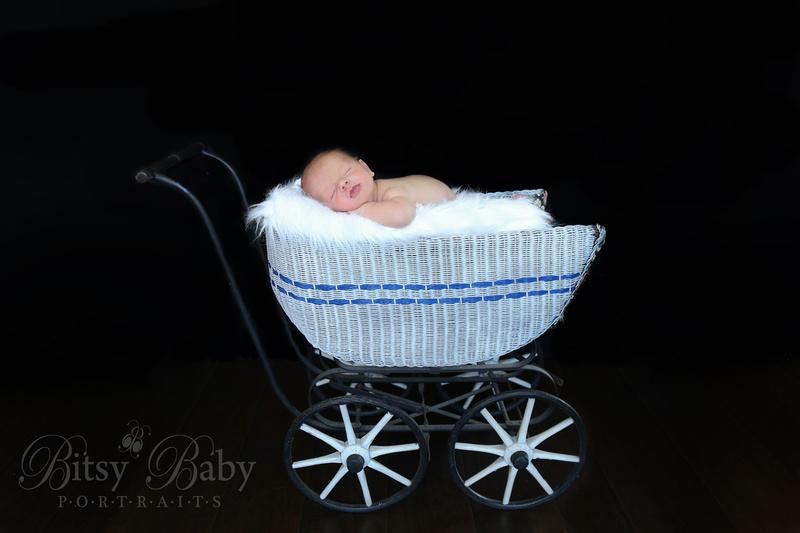 Baby in a vintage pram stroller