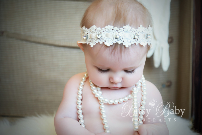 Baby in antique suitcase, luggage, pearls, 6-month old